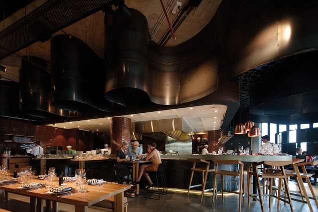 A two-metre-wide steel ribbon snakes above the restaurant.
