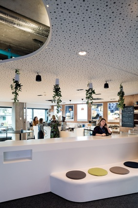 A café was positioned near the front door, a move seeking to represent the buzz and dynamism of the organisation.
