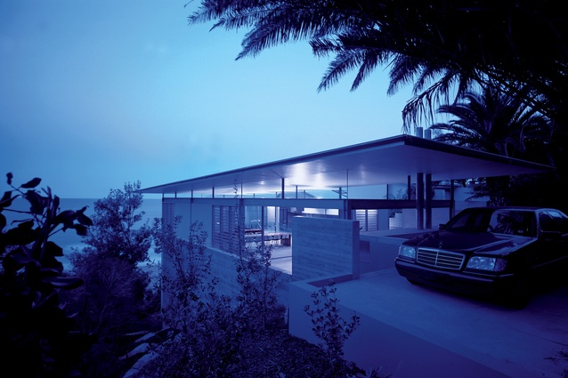 """The upper floor of Archer House is topped with a """"hovering roof,"""" which falls toward the view."""