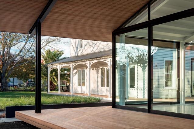 The original villa sits alongside a newly-built warehouse-type structure.