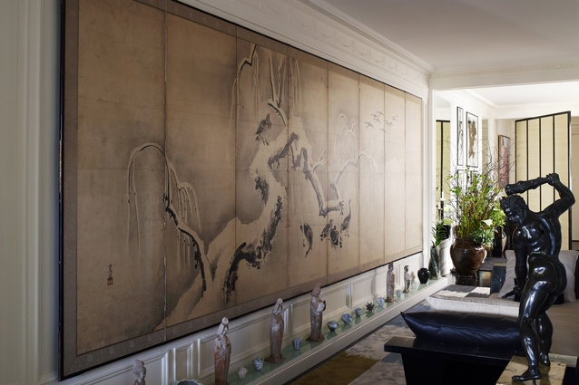 Panelled artwork spans one of the apartment walls.