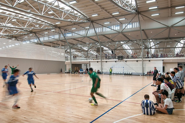 Natural light streams through the bow trusses into the sports hall. The colourful sports teams and equipment are only a distraction within a subtle colour scheme.