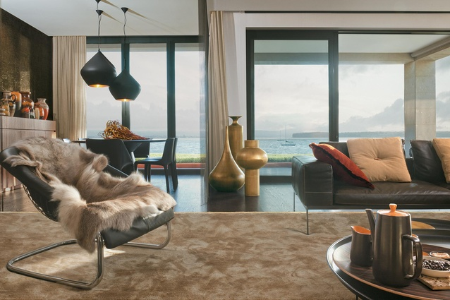The living room is filled with design classics like the Lifesteel sofa by Flexform, Fat Fat tables by B&B Italia, and a Cortina armchair by Minotti.