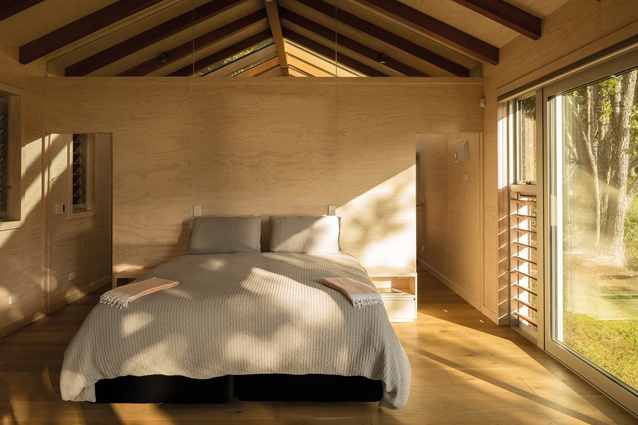 The bedroom space is light-filled and peaceful.