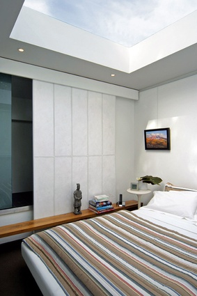 A large skylight above the bed in the upper-floor bedroom allows unobstructed views of the sky.