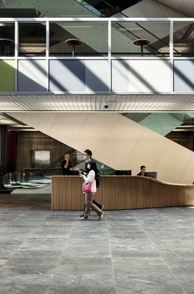 The building's front desk, as well as a number of other furniture items, were designed by Jasmax.