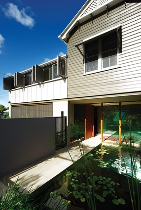 Integrating ponds into the Bulimba House emphasises the transition from the street to the shade of the house.