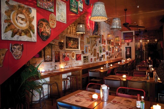 Raw brick walls are adorned with hundreds of pictures, postcards and Mexicana.