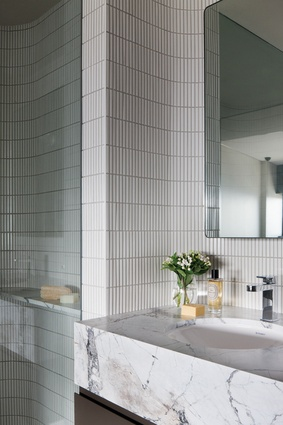 The dialogue between the building's geometry and the interior spaces is strongly expressed in the bathrooms.