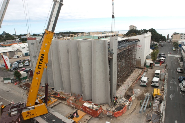 Contractors took over half the road on both sides of the building to crane in the façade panels.