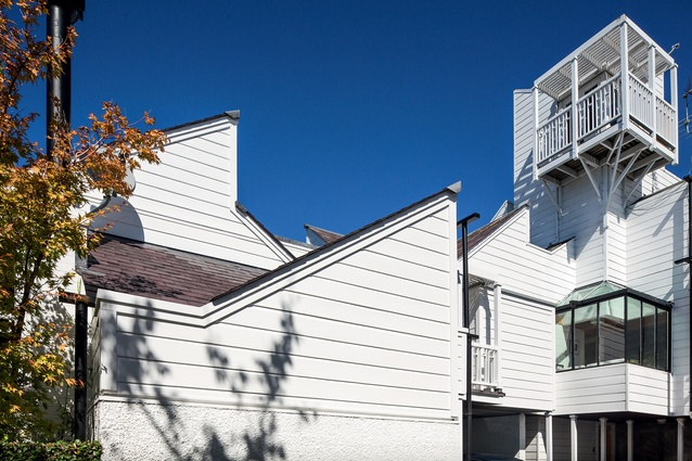 The Cocker Townhouses is a composition of prismatic forms in white weatherboards with shingle roofs, overlaid with filigreed timber balconies.