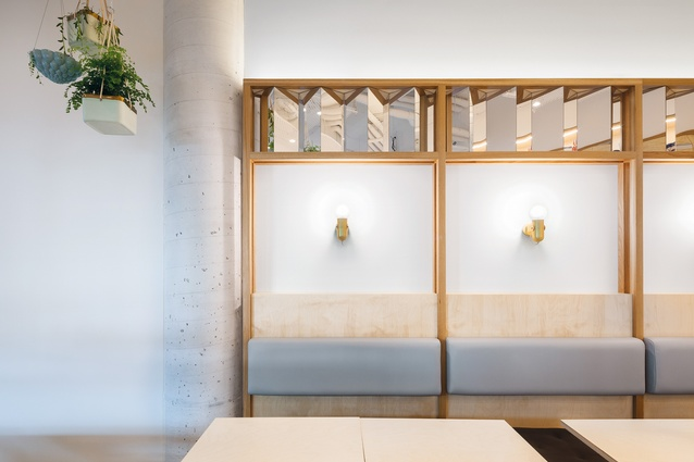 """Plywood joinery incorporating """"flickers"""" of mirror is intended to express the client's flickering memories of vietnam."""