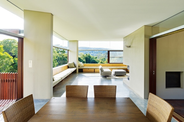 The corner of the living room opens up to the landscape beyond.