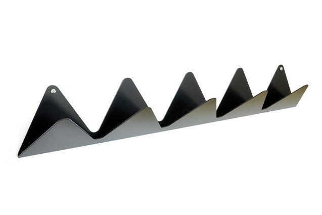 The Triangulate coat rack, made from folded steel, designed to hold coats, keys and mail.