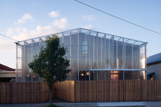 View of the northern facade. A screen of transparent polycarbonate encloses verandah spaces on the northern and western edges.