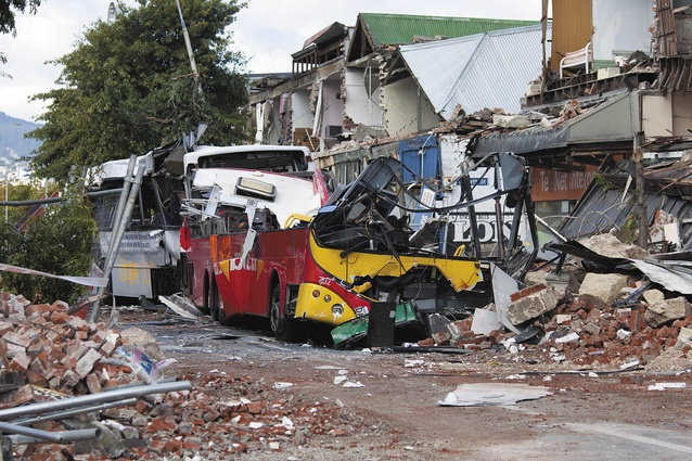 On 22 February 2011 Ann Brower was sitting in this red bus when the façade of 603 and 605–613 Colombo Street collapsed, killing eight passengers and four pedestrians.