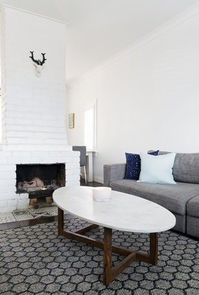 Marble-topped table: This met several design requirements: first, they love the balance between marble and wood. Second, it's the perfect shape.