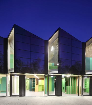 Nursery +E, Germany. The building features a striking folded glass exterior and is designed as a surplus energy house.