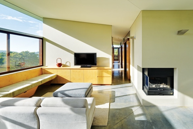 The living spaces open up to natural light and panoramic views.