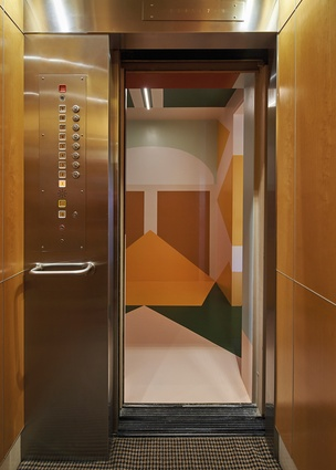 An Esther Stewart mural covers the walls and ceiling in the entry from the lift.