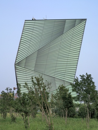 The Centre for Sustainable Energy Technology (CSET) in Ningbo, China. The building is covered with a double skin of glass and includes a rooftop opening for natural ventilation.