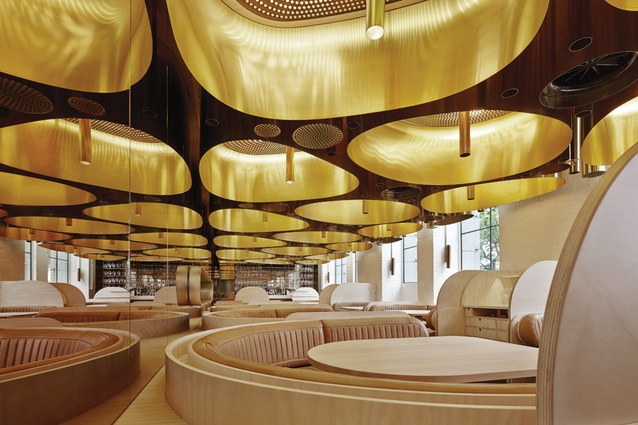 The custom-designed brass light fittings also work as acoustic baffles.