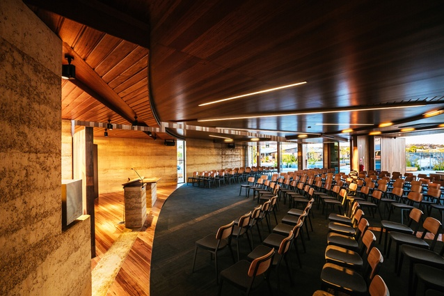 The arcs of the two rammed earth walls intersect at the altar.