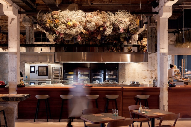 The interior of urban eatery Amano evokes the joy and freshness of an Italian marketplace.