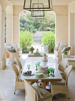Modern lighting elements add a twist to this classical outdoor living space.