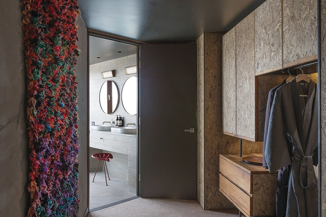 An array of textures, such as the handwoven rug hung on the wall, adds to the rooms' lived-in feeling.