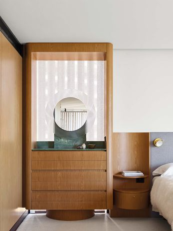 Custom dressers and bedside tables echo the circular pattern and reflect Alcorn Middleton's attention to detail.