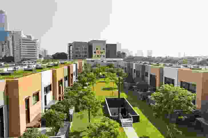 The staff residential neighbourhood is centred around a large landscaped area, accessible from a basement carpark.