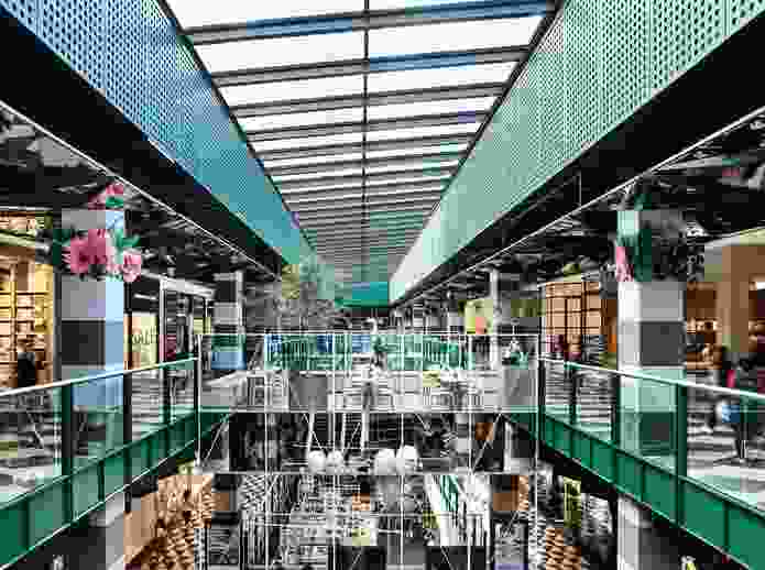 Pattern, colour and reflection help to bring a dynamic and ephemeral quality to Melbourne Central Arcade.
