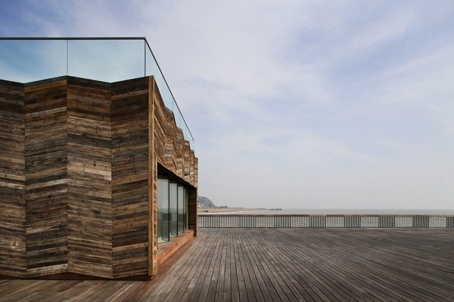 The new visitor centre of Hastings Pier by DRMM is a CLT structure clad in recycled timber.