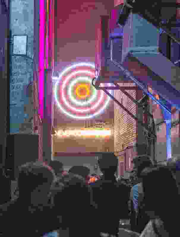 SAF launch in Temperance Lane, Sydney — beneath the neon tinge of Steenson Varming's light installation.
