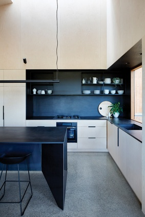 The neatly designed kitchen is tucked into the eastern corner of the main living space.