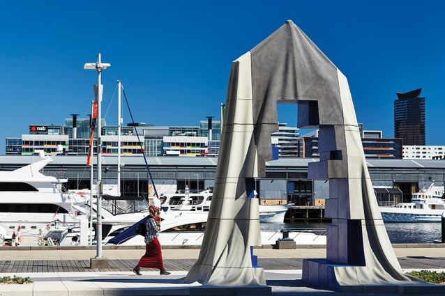 A void in one of the sculptures frames a view of Central Pier – one of the few remnants of Docklands' maritime history.