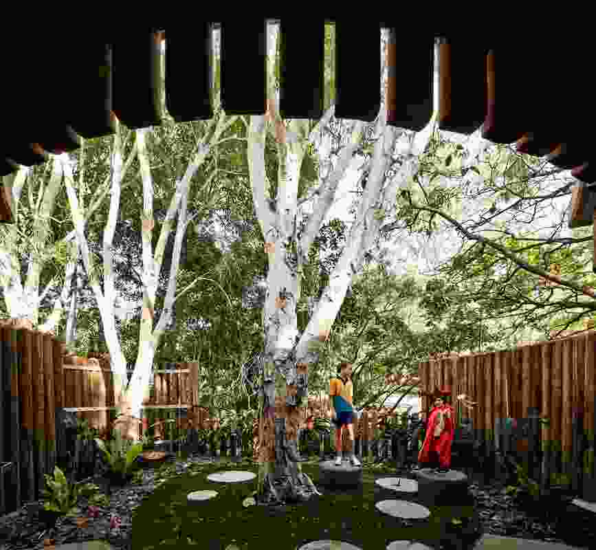 Fences and sunshades constructed from Koppers logs lend the play areas a sense of whimsy.