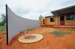 A curved windbreak was used at Canteen Creek for both privacy and shelter. Its position could be customized to suit house orientation and householder requirements.