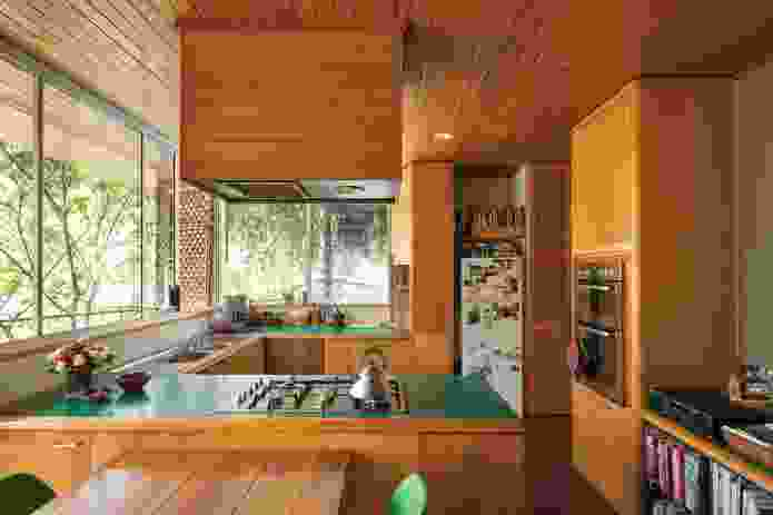 The classic early-eighties kitchen features emerald green laminate and African ash timber for domestic warmth.