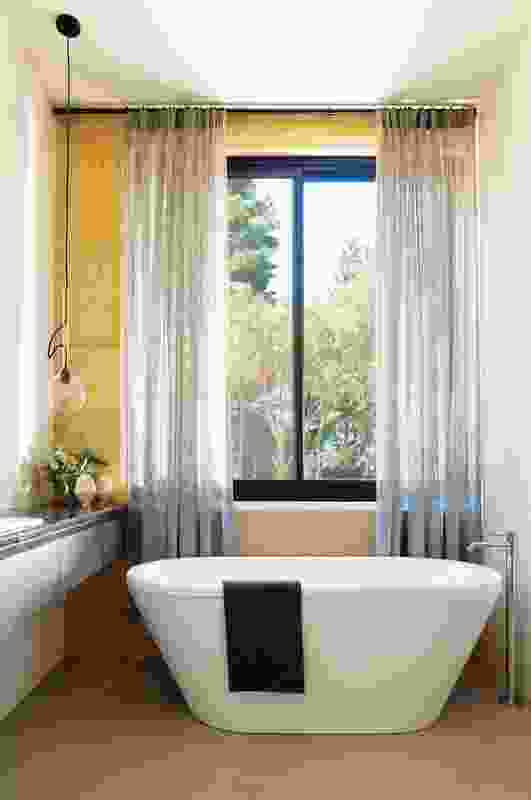 An ensuite in the parents' zone offers views to greenery.
