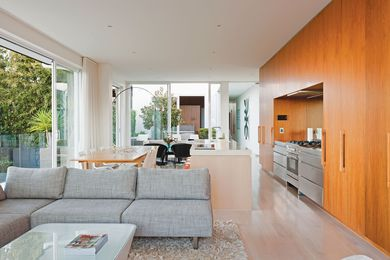 Large, sliding glass panels open up the living space to the central courtyard.