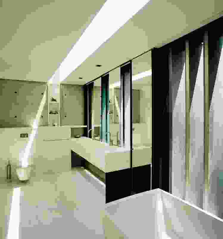 The off-form concrete is expressed in the bathroom.
