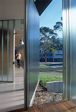 A sheet of clear glass looks south as the glass plank wall kinks inwards.