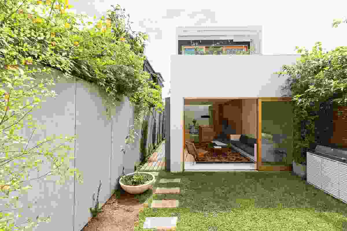 The living space opens out to the garden and garage beyond.