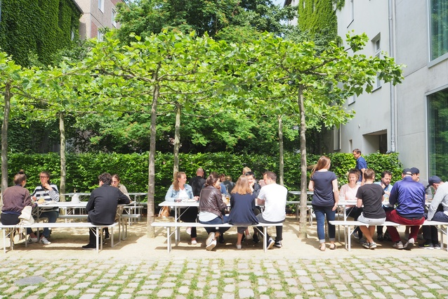 A planted courtyard with a café and restaurant outside David Chipperfield Architects' office.