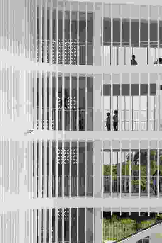 Concrete louvres and perforated walls protect corridors from direct sun while allowing for natural ventilation.