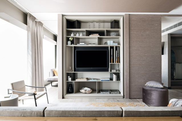 In the bedrooms, custom-designed open joinery incorporates storage and the television in an unobtrusive way.