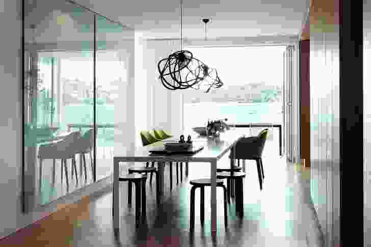 The dining room opens onto a waterside deck.