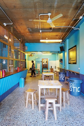 Bar Económico's colour scheme was influenced by Caribbean dive bars. walls have been purposefully treated to look repainted.